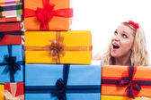 Surprised woman with presents — Stock Photo
