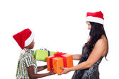Christmas family giving presents — Stock Photo