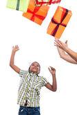 Child boy catching Christmas presents — Stock Photo