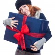 Pleased woman with big present — Stock Photo