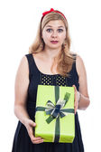 Shocked woman with present — Stock Photo