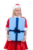 Excited Christmas woman holding big present — Stock Photo
