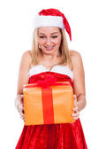 Surprised Christmas woman with present — Stock Photo