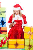 Christmas woman texting message — Stock Photo