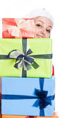 Happy Christmas woman behind presents — Stock Photo