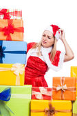 Worried Christmas woman looking at presents — Stock Photo