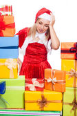 Stressed Christmas woman with presents — Stock Photo