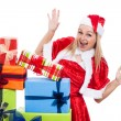 Stock Photo: Exited Christmas womwith presents