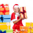 Cheerful Christmas woman with presents — Stock Photo