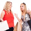 Excited girls shopping and talking — Stock Photo