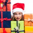 Christmas woman with presents looking up — Stock Photo