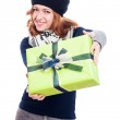 Happy woman in winter hat with present — Stock Photo