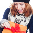 Exited woman opening present — Stock Photo