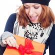 Stock Photo: Exited womopening present