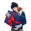Pleased woman with big present — Stock Photo #31174117