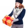 Serious woman with gift — Stock Photo #31174155