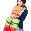 Surprised woman carrying many presents — Stock Photo #31174253