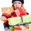 Surprised woman with many presents — Stock Photo