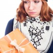 Unhappy woman with present — Stock Photo