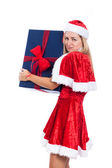 Greedy Christmas woman with big present — Stock Photo