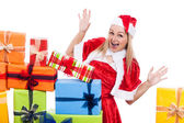 Exited Christmas woman with presents — Stock Photo
