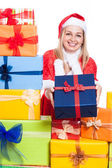 Happy Christmas woman giving presents — Stock Photo