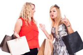 Excited girls shopping and talking — Stockfoto