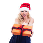 Exited Christmas woman giving present — Stock Photo