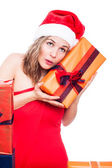 Curious Christmas woman with present — Stock Photo