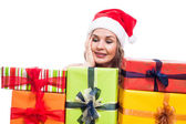Pleased Christmas woman with presents — Stock Photo
