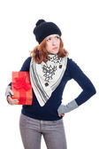 Serious woman with present — Stock Photo