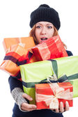Surprised woman with many presents — Стоковое фото