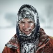 Happy man in snow — Stockfoto