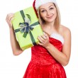 Smiling Christmas woman with present — Stockfoto