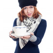 Winter woman holding mug of tea or coffee — Stock Photo