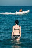 Woman walking in sea — Stock Photo