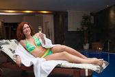 Woman enjoying wellness and spa swimming pool — Stock Photo