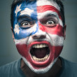 Angry man with USA flag painted on face — Stock Photo #47353595