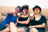 Group of happy sports fans pointing — Stock Photo