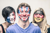Happy people with European flags on faces — Stock Photo