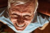Senior man toothy laugh — Stock Photo