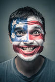 Funny man with US flag painted on face — Stock Photo