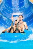 People water slide at aqua park — Foto de Stock