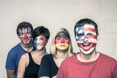 Funny people with painted flags on faces — Stock Photo