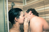 Lovers kissing in shower — Stock Photo