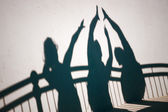 Shadows of people gesturing high five — Stockfoto