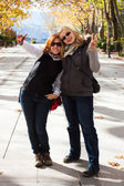 Happy women in park — Stockfoto