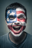 Exited man with US flag painted on face — Stock Photo