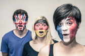 Surprised people with European flags on faces — Stock Photo