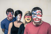 Scary people with flags on faces — Stok fotoğraf